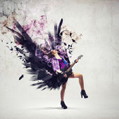 Rock passionate girl with black wings — Stock Photo