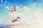Image of jumping businesswoman — Stock Photo
