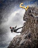 Busiessman climbing mountain — Stock Photo