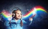 Little girl in headphones — Stock Photo