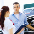 Young man at car salon — Stock Photo