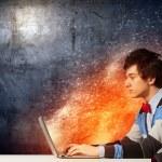 Businessman using laptop — Stock Photo #29085035