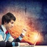 Businessman using laptop — Stock Photo #29085141
