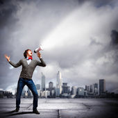 Young man with megaphone — Stock Photo