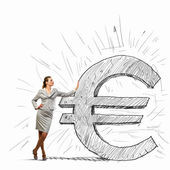 Businesswoman leaning on euro sign — Stock Photo