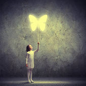 Little cute girl with butterfly balloon — Stock Photo