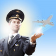 Image of pilot with plane in hand — Stock Photo