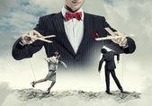 Businessman puppeteer — Stock Photo