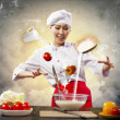 Foto Stock: Asian female cooking with magic