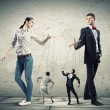 Businesspeople with marionettes — Stock Photo #29142767