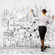 Businesswoman drawing on wall — Stock Photo #29195979