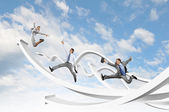 Businesspeople jumping — Stock Photo
