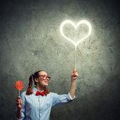 Chica adolescente con caramelo — Foto de Stock