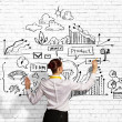 Businesswoman drawing on wall — Stock Photo #29301255