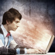 Stock Photo: Businessman using laptop