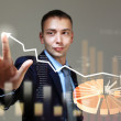 Young businessman touching icon — Stock Photo
