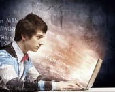 Businessman using laptop — Stock Photo