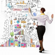 Businesswoman drawing on wall — Stock Photo #29314357