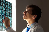 Man doctor looking at x-ray — Stock Photo