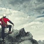 Young tourist atop of mountain — Stock Photo #29410055