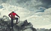 Young tourist atop of mountain — Stock Photo