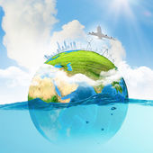 Earth planet in water — Stock Photo