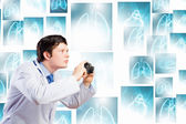 Doctor with photo camera — Stock Photo