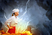 Asian female cook in anger — Stock Photo
