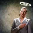 Stock Photo: Saint businesswoman