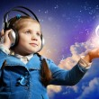 Little girl in headphones — Stock Photo #29480887