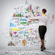Businesswoman drawing on wall — Stock Photo #29481999