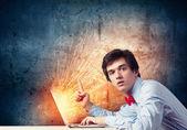 Businessman using laptop — Stock Photo
