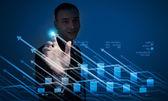 Young businessman touching icon — Stockfoto