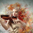 Stock Photo: Gorgeous womplaying on violin