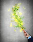 Human hand holding paint brush — Stock Photo