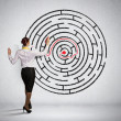 Businesswoman solving maze problem — Stock Photo