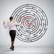 Businesswoman solving maze problem — Stock Photo