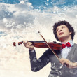 Young man violinist — Stock Photo