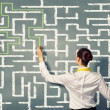 Businesswoman solving maze problem — Stock Photo #29845539
