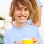Young happy man drinking tea — Stock Photo #29847229
