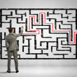 Businessman solving labyrinth problem — Stock Photo #29847379
