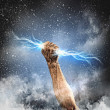 Human hand holding lightning — Stock Photo #29896239
