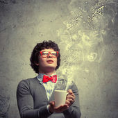 Young man with smoke coming out of cup — Stock Photo