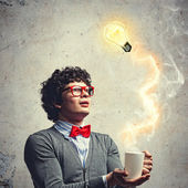 Young man with an electric bulb — Stock Photo
