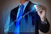 Business man drawing graphics — Stock Photo