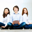 Three students smiling — Stock Photo