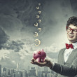 Young businessman holding moneybox — Stock Photo