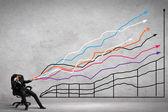 Businessman pulling graph — Stock Photo