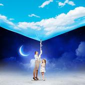 Family pulling banner — Stock Photo