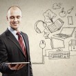 Businessman with ipad in hands — Stock Photo #30053587